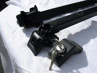 Pair of adjustable & lockable roof bars for attachment to manufacturer installed roof rails