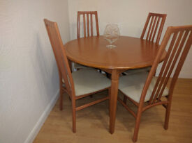 Dining room table, chairs (4) and sideboard