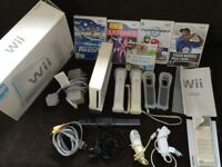 Wii Console with 2 remotes, 2numchuks, Wii sport Mario and other games