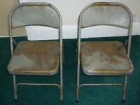 Get the look. A pair of 'industrial' metal folding chairs. Right on trend.