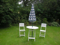 White garden table and chairs, with sunshade