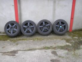 set of 4 black 5 spoke alloy wheels 235/55r17 (VW Audi).