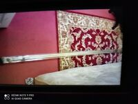 Gold extendable curtain rod. Brand New packed. Collect today cheap