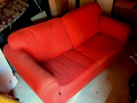 John Lewis red sofa bed - well loved but in great condition; super comfortable spring mattress!