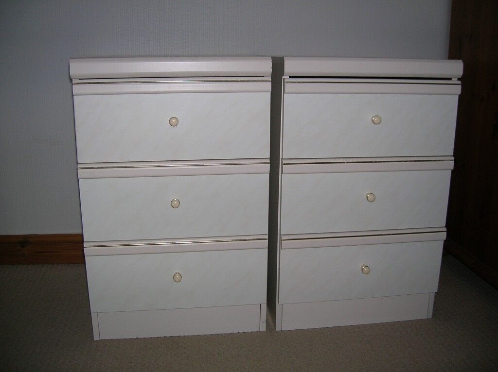 Two cream Hygena bedside cabinets with gold trim. Three drawers.
