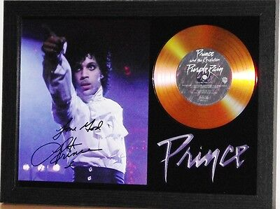 PRINCE SIGNED PHOTO AND 'PURPLE RAIN' GOLD DISC
