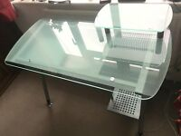Glass office desk with chair