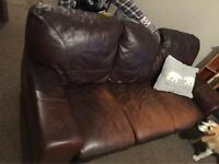 Distressed leather effect sofa