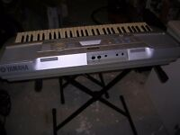Yamaha electric keyboard with stand and stool.