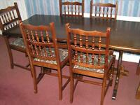 Solid wood dark oak finish dining table with 6 chairs (including 2 carvers)