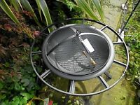 Phoenix round fire pit with mesh cover