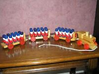 Collectible pull along wooden train set - train, 3 carriages and 30 painted soldiers