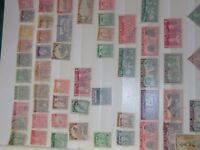 COLLECTION OF 840 NEW ZEALAND USED STAMPS IN STOCK BOOK.
