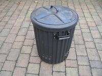 Old fashioned dustbin with lid