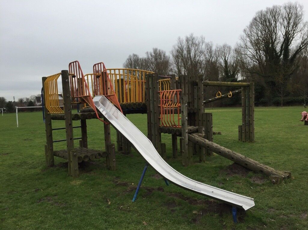 Large wooden kids climbing frame with slide. Bolts together. Free if ...