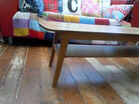 mid century coffee table, in the iconic 'sleigh' style long, sleek body
