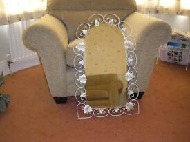 Decorative mirror with leaf design. £15