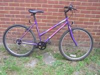 LADYS MOUNTAIN BICYCLE By UNIVERSAL. GOOD CONDITION READY TO RIDE AWAY