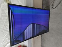 Two TVs with broken screens Spares or repairs