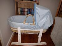 Baby blue Moses basket and white wooden rocking stand
