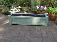 Pale Green wooden garden planters lined with polythene