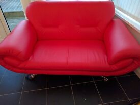 Two red sofas. A three seater and two seater