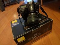Nikon D7000 + 24-85mm ed + battery grip