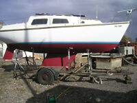 Leisure 23 fin keel 4/5 berth sailing cruiser with Yanmar 1GM and road trailer, lying N.Fambridge.