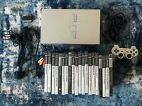 PlayStation 2 console, limited edition silver with games, tested working