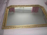 gold coloured ornate mirror