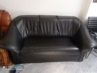 Faux leather two seater sofa for free