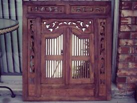 Carved wooden mirror with shutter