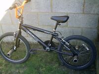 Boys BMX with Giro with 20 inch wheels and stunt nuts