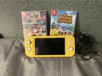Nintendo Switch Lite With Charger, Plus Mario Kart And Animal Crossing