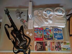 Wii Console (with many accessories), Guitar, Fit Board + 6 Games