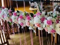 Aisle flower balls 14 can also be used as table decorations