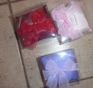 4 NEW in package scented potpourris cushions, air freshener