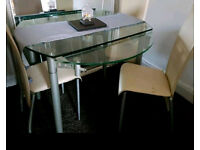 Glass dining table-rectangle extends to a round table & 4 chairs