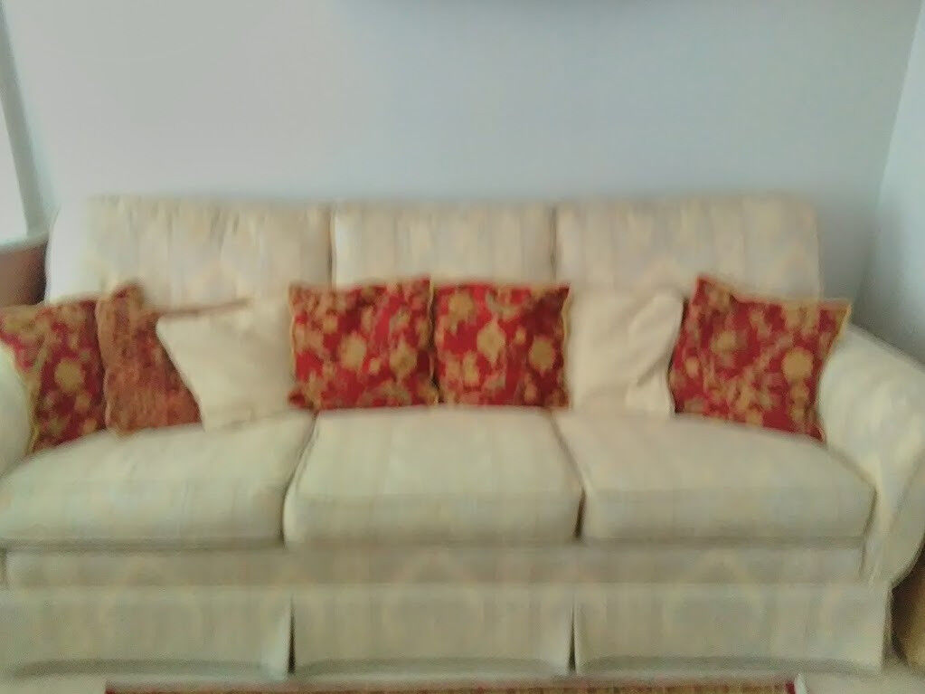 Three seater sofa, two chairs and foot stool with storage