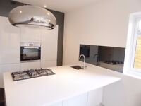 Newly refurbished, luxury three bed, two bath split level apartment in Sutton with garden
