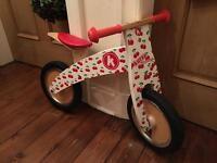 Kiddimoto Kurve balance bike with cherry pattern