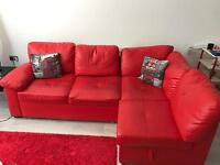 Red leather sofabed with storage