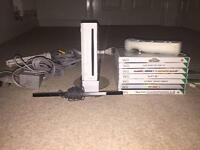 NINTENDO WII AND 8 GAMES, ALONG WITH CONTROLLER AND GOLF CLUB ATTACHMENT £60.