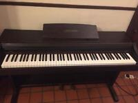 Casio Celviano AP 21 digital electric piano and stool