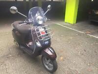 Vespa lx touring 125