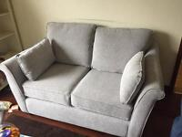 Brand new grey fabric two seater sofa