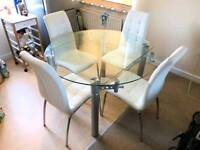 4 White Faux Leather dining chairs with expandable glass table