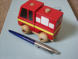 wooden toy fire engine in its box