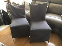 Two cast iron chairs in need of TLC
