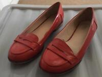 Red patient shoes.